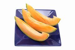 Cantaloupe slices Stock Photos