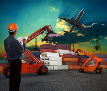 working man in logistic business working in container shipping yard with dusk - stock illustration