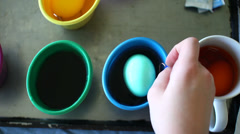 Taking Easter egg out of coloring and placing on holder Stock Footage