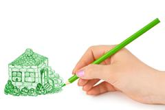 Hand drawing house - stock photo