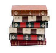 Stack of old books with gilt tooled spines Stock Photos