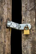 Old key lock on wooden door Stock Photos