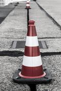 red and white traffic cone shoot on the tempelhofer feld, berlin germany - stock photo