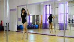 Strip dancer training in fitness club - stock footage