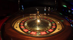 Shot of a casino roulette - the spinning ball stops at black 15 Stock Footage