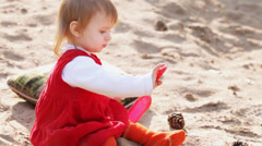 Little girl on sand with toys Stock Footage