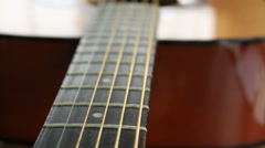 Acoustic guitar body, neck and headstock on the table, close-up - stock footage