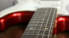 Electric red guitar on the table, close-up - stock footage