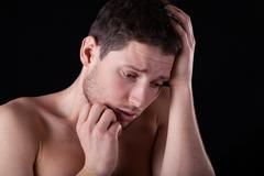 miserable naked man - stock photo