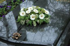 Funeral flowers on a tomb Stock Photos