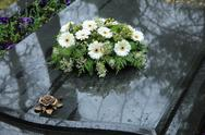 Stock Photo of funeral flowers on a tomb