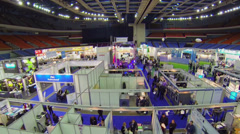 People walk among stands at International Exhibition ExpoClean Stock Footage
