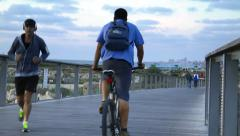 Runners, cyclists and passersby on Tel Aviv's promenade Stock Footage