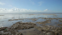 High tide water floods up river dee estuary, wirral, england Stock Footage
