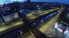 Metro train passes by Preobrazhensky bridge over river and quay Stock Footage