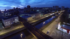 Cars drive by Gannushkina quay under metro bridge Stock Footage