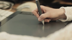 Hands of a woman working with drawing tablet for a computer Stock Footage