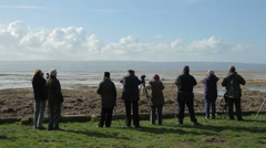 Bird watchers, rspb nature reserve on river dee estuary at parkgate, England Stock Footage