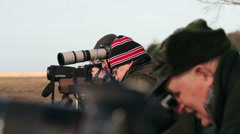 Bird watchers at rspb nature reserve on river dee estuary at parkgate, wirral Stock Footage