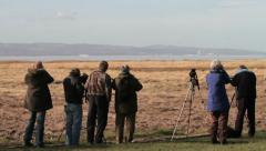 Bird watchers at rspb nature reserve, river dee estuary at parkgate, wirral Stock Footage