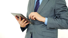 Businessman hands typing on tablet, isolated on white Stock Footage