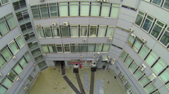 Inner yard of pentagon shaped building with windows of offices Stock Footage