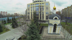 Small chapel near Moscow City Court complex at autumn Stock Footage
