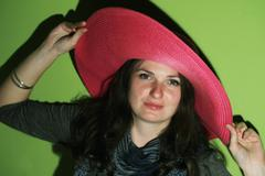 brunette with pinky hat - stock photo
