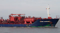 Tanker ship, nordic marianne sails up the river mersey, liverpool Stock Footage