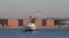 Mersey ferry crosses river mersey, liverpool, england Stock Footage