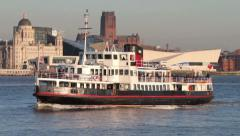 mersey ferry crosses river mersey in front of liverpool skyline, england - stock footage