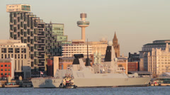 Tugs pulling off quay, royal navy war ship, hms dragon, Liverpool Stock Footage