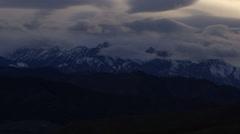 Slow pan of Snowy Mountain range in fog Stock Footage