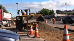 Construction, road widening, front loader Stock Footage