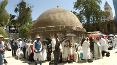 Ethiopian Orthodox pilgrims on Maundy Thursday before Easter Stock Footage