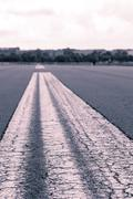 worms eye vintage shoot of a road marking on an airstrip - stock photo