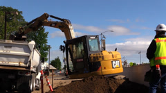 Construction, road widening, hauling dirt, Stock Footage