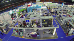 People walk by area of International Exhibition ExpoClean Stock Footage