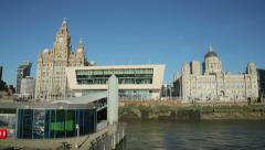 Pov of ferry coming into pierhead at liverpool waterfront skyline, england Stock Footage