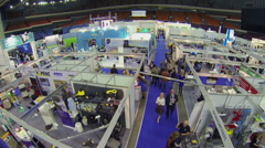 People walk near stands at International Exhibition ExpoClean Stock Footage