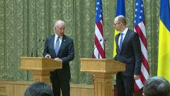 Joe Biden speaks to journalists. - stock footage