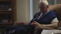 Elderly man on iPad in Robe Stock Footage