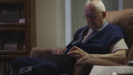 Stock Video Footage of Elderly man on iPad in Robe