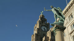 cunard war memorial and liver building at liverpool pier head - stock footage