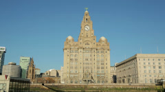 Pov of ferry leaving pierhead at liverpool liver building skyline, england Stock Footage