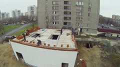 Workers build brick wall of small edifice in Bogorodskoe Stock Footage