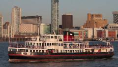 Mersey ferry crosses river mersey in front of liverpool skyline, england Stock Footage