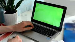 Man studies (learns) and works on the computer (green screen) Stock Footage