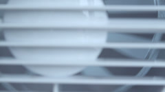 Close-up of white ventilator blowing fresh air, camera moving up - stock footage