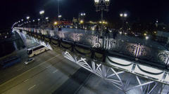 People walk by Patriarshy bridge above quay with traffic Stock Footage